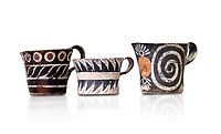 "Minoan Kamares ""eggshell"" ware cups with  with  polychrome decorations, from set found at Phaistos Palace 1800-1600 BC; Heraklion Archaeological  Museum, white background.<br /> <br /> These cups found as parts of sets in Phaistos palace were names ""eggshell"" ware due to the very thin walls of the cups. This style of pottery is named afetr Kamares cave where this style of pottery was first found"