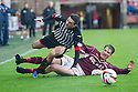 Pars' Shaun Byrne is brought down by Stenny's Sean Lynch.