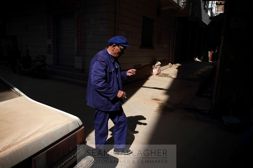 CHINA. A elderly man in Zijun village in Kunming, home of the Samatao minority. 2010