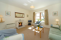 """BNPS.co.uk (01202) 558833. <br /> Pic: KnightFrank/BNPS<br /> <br /> Pictured: Holiday let living room. <br /> <br /> A castle that was burnt down by a pirate, involved in the English Civil War and has been in the same family for five centuries is on the market for offers over £650,000.<br /> <br /> Kilberry Castle, which dates back to the 15th century, has an incredible history and still has a wealth of original features including a 288-year-old mausoleum.<br /> <br /> It sits in 21 acres of land on the Scottish west coast, with stunning views over Kilberry Bay and out to the islands of Islay, Jura and Gigha.<br /> <br /> The four-storey tower house now needs a buyer """"with deep pockets and great imagination"""" to carry out a complete refurbishment but it has a lot of potential."""