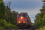 Canadian National freight train passing through a farming community in Exeland, Wisconsin.