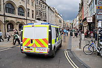 Police van parked in Cornmarket, Oxford city centre.