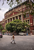 A pedestrian walks towards the Writers Building, the secretariat building of the State Government of West Bengal in BBD Bagh in Kolkata, West Bengal  on Friday, May 26, 2017. Photographer: Sanjit Das