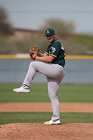 Oakland Athletics relief pitcher JB Wendelken (58) prepares to deliver a pitch to the plate during a Minor League Spring Training game against the Chicago Cubs at Sloan Park on March 13, 2018 in Mesa, Arizona. (Zachary Lucy/Four Seam Images)