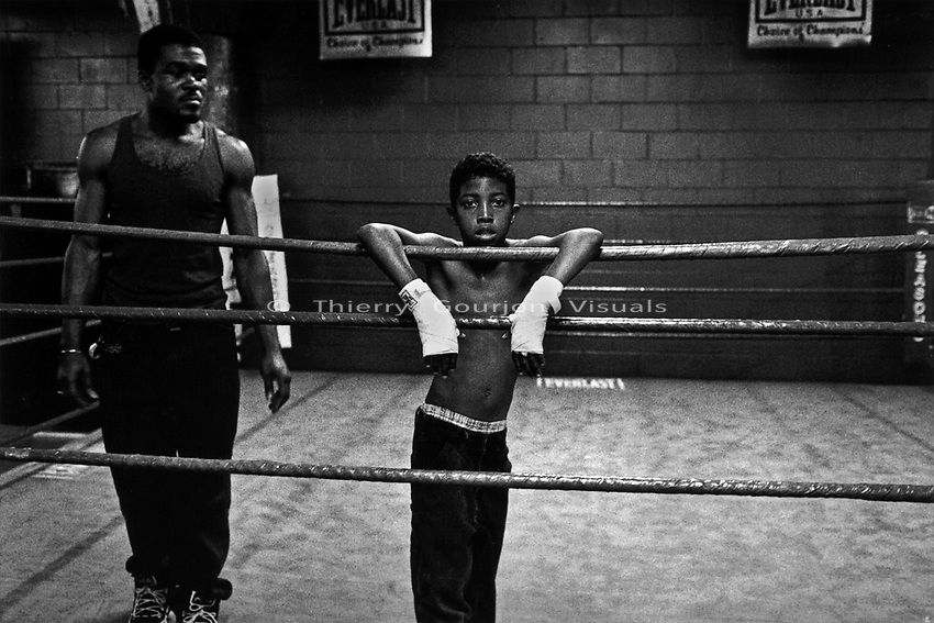 A young fighter between rounds at Gleason's Gym, Brooklyn, New York.<br />Photograph by Thierry Gourjon-Bieltvedt. 1995-2005