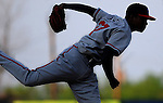 RHP Julio Teheran (27) of the Rome Braves, Class A affiliate of the Atlanta Braves, is silhouetted against the darkening sky in a game against the Greenville Drive April 14, 2010, at Fluor Field at the West End in Greenville, S.C. Teheran is the No. 51 top prospect in baseball according to Baseball America, and Atlanta's No. 3 prospect. Photo by: Tom Priddy/Four Seam Images
