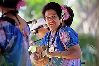 EDITORIAL ONLY. Auntie Genoa Keawe playing ukulele and singing at the Ka Hula Piko Festival on Molokai