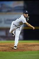 Pulaski Yankees relief pitcher Jhonatan Munoz (43) follows through on his delivery against the Burlington Royals at Calfee Park on August 31, 2019 in Pulaski, Virginia. The Yankees defeated the Royals 6-0. (Brian Westerholt/Four Seam Images)