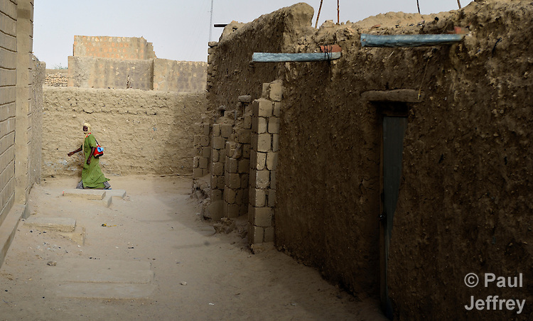 A man walks along a street in Timbuktu, the northern Mali city that was seized by Islamist fighters in 2012 and then liberated by French and Malian soldiers in early 2013.