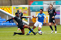 1st May 2021; Weston Homes Stadium, Peterborough, Cambridgeshire, England; English Football League One Football, Peterborough United versus Lincoln City; TJ Eyoma of Lincoln City slides in and fouls Nathan Thompson of Peterborough United