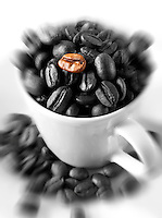 Individual coffee beans in a coffee cup. Stock Photo.