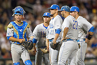 UCLA catcher Shane Zeile (14) and pitcher Nick Vander Tuig (21) wait for head coach John Savage to come to the mound against the North Carolina State Wolfpack during Game 8 of the 2013 Men's College World Series on June 18, 2013 at TD Ameritrade Park in Omaha, Nebraska. The Bruins defeated the Wolfpack 2-1, eliminating North Carolina State from the tournament. (Andrew Woolley/Four Seam Images)