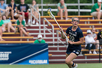 NEWTON, MA - MAY 22: Hannah Dorney #22 of Notre Dame looks to pass during NCAA Division I Women's Lacrosse Tournament quarterfinal round game between Notre Dame and Boston College at Newton Campus Lacrosse Field on May 22, 2021 in Newton, Massachusetts.