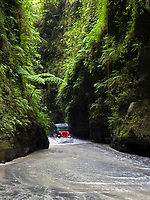 Drive through gorges with towering walls of mountain and lahar, across desert- like ground of sand and ash to the the Puning Hot Springs in Pampanga, Philippines, created by Mt Pinatubo's cataclysmic eruption in 1991.