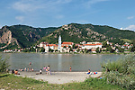 Austria, Lower Austria, UNESCO World Heritage Wachau, view from Wachau Lido at Rossatzbach across Danube towards wine town Duernstein with the blue-white tower of the Collegiate Church and Castle Ruin Duernstein, the legend says that King Richard I Lionheart has been kept imprisoned 1192 untill 1194