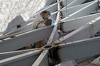 - worker welder in the yard of new Milan fair at Rho-Pero....- operaio saldatore nel cantiere della nuova fiera di Milano a Rho-Pero