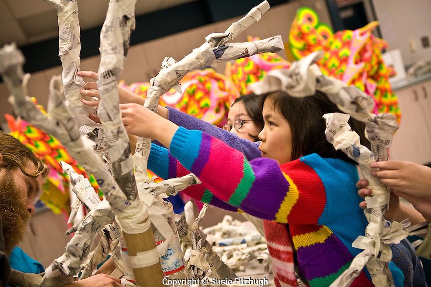 """Students in Lana Sundberg's Visual Art class at Kimball Elementary School, Seattle, make creatures for an Arts Corps/Planet Arc sculptural piece celebrating the """"Seeds of Compassion"""" movement."""