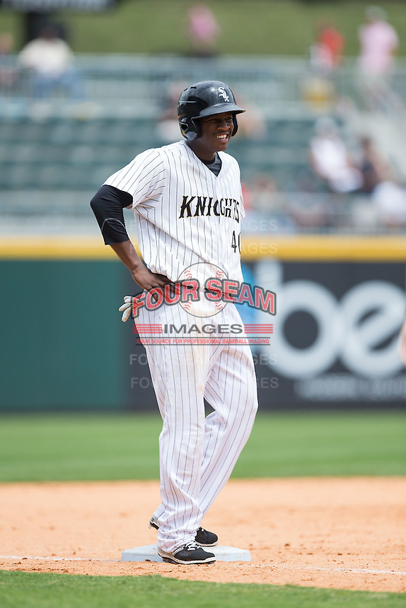 Alexander Simon (40) of the Charlotte Knights stands on third base during the game against the Gwinnett Braves at BB&T BallPark on July 3, 2015 in Charlotte, North Carolina.  The Braves defeated the Knights 11-4 in game one of a day-night double header.  (Brian Westerholt/Four Seam Images)