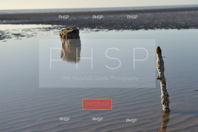 18/03/2011 Barnacle encrusted former jetty support beyond Central Pier, Blackpool Lancashire UK......© Phill Heywood.