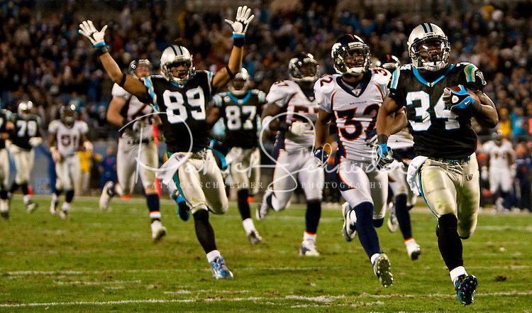 Carolina Panthers running back DeAngelo Williams (34) score a touchdown against the Denver Broncos during an NFL football game at Bank of America Stadium in Charlotte, NC.