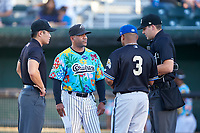 Idaho Falls Chukars managers Omar Ramirez (11) and Juan Francia (3) during the lineup exchange before a Pioneer League game against the Missoula Osprey at Melaleuca Field on August 20, 2019 in Idaho Falls, Idaho. Idaho Falls defeated Missoula 6-3. (Zachary Lucy/Four Seam Images)