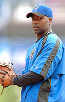 3 April 2006: Carlos Delgado, first baseman for the New York Mets, warms up prior to the Opening Day game against the Washington Nationals at Shea Stadium, in Flushing, New York. The Mets defeated the Nationals 3-2 to lead off the 2006 MLB season...Mandatory Photo Credit: Ed Wolfstein Photo..