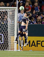 LA Sol's Camille Abilly leaps high for a ball against Sky Blue goalkeeper Jenni Branam. The LA Sol defeated Sky Blue FC 1-0 at Home Depot Center stadium in Carson, California on Friday May 15, 2009.   .