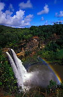 Wailua falls on a bright sunny day with rainbow