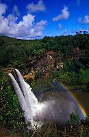 Wailua falls on a bright sunny day with rainbow
