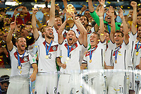 Benedikt Howedes of Germany celebrates winning the FIFA World Cup trophy with team mates