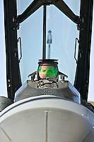 Pilot in fighter plane cockpit.