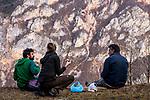 Balkan Lynx (Lynx lynx balcanicus) biologists, Alexander Pavlov, Lilli Middelhoff, and Dime Melovski, eating lunch in mountains, Mavrovo National Park, North Macedonia