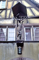 Riquewihr: Rampant stag on wall of house.