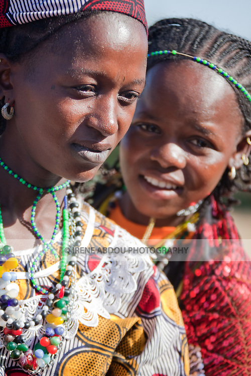 Young Fulani women in the seasonal village of Bantagiri in northern Burkina Faso.  The Fulani are traditionally nomadic pastoralists, crisscrossing the Sahel season after season in search of fresh water and green pastures for their cattle and other livestock.