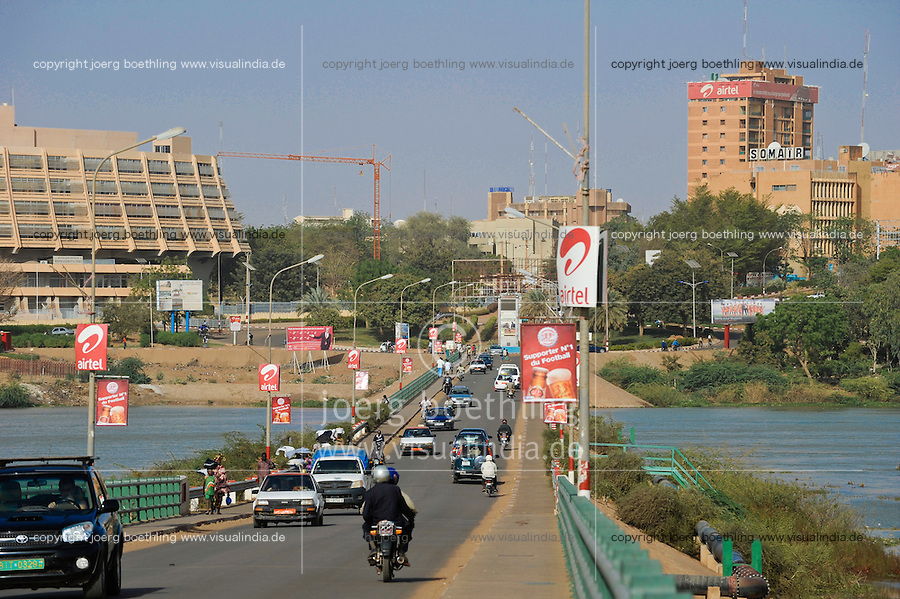 NIGER Niamey, Kennedy bridge over Niger river, on the right headquarter of Uranium company SOMAÏR which is owned with 63,6 % by french company AREVA / NIGER Niamey, Kennedy Bruecke ueber den Fluss Niger, links Hotel Gaweye und rechts Headquarter der Uranfirma SOMAIR, SOMAÏR (Société des Mines de l'Aïr) was created in 1968. Its capital is held 63.6% by AREVA and 36.4% by SOPAMIN , Société du Patrimoine des Mines du Niger, the Nigerien agency that manages the State's mining interests like Uranium