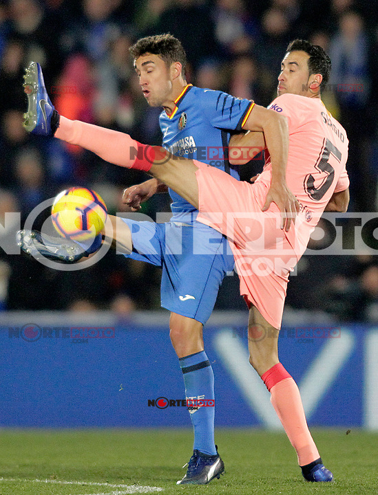 Getafe CF's Jaime Mata (l) and FC Barcelona's Sergio Busquets during La Liga match. January 6,2019. (ALTERPHOTOS/Acero) /NortePhoto.com