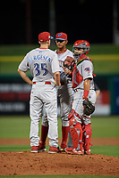 Clearwater Threshers pitching coach Brad Bergesen (35) talks with relief pitcher Gustavo Armas (29) and catcher Rodolfo Duran (19) during a Florida State League game against the Dunedin Blue Jays on April 4, 2019 at Spectrum Field in Clearwater, Florida.  Dunedin defeated Clearwater 11-1.  (Mike Janes/Four Seam Images)