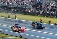 Apr. 29, 2011; Baytown, TX, USA: NHRA funny car driver Melanie Troxel (left) races alongside Terry Haddock during qualifying for the Spring Nationals at Royal Purple Raceway. Mandatory Credit: Mark J. Rebilas-