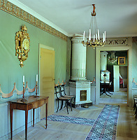 The original dining room features carpets printed on widths of heavy linen, hand painted wallpaper and an ormolu chandelier