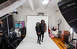 WATERTOWN, CT-010921JS09- Destinee Hendricks and her mother Yonique Hendricks get ready to get their photo taken during a portrait session Saturday at Clay Johnson Studio in Watertown. Mothers and daughters from the Waterbury chapter of the NAACP had their photos taken in pearls to compile a book to be sent to VP-Elect Kamala Harris. <br /> Jim Shannon Republican-American