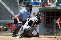 Charlotte Knights catcher Brett Austin (22) blocks a pitch in the dirt as home plate umpire Ryan Wills looks on during the game against the Indianapolis Indians at BB&T BallPark on August 22, 2018 in Charlotte, North Carolina.  The Indians defeated the Knights 6-4 in 11 innings.  (Brian Westerholt/Four Seam Images)