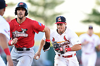 Springfield Cardinals shortstop Greg Miclat (3) chases down Jake Skole (5) during a run down during a game against the Frisco Rough Riders on June 1, 2014 at Hammons Field in Springfield, Missouri.  Springfield defeated Frisco 3-2.  (Mike Janes/Four Seam Images)