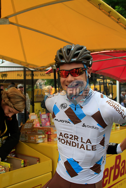 Nicolas Roche (IRL) AG2R La Mondiale fills up from the food bar at sign on before the start of Stage 2 of the 99th edition of the Tour de France 2012, running 207.5km from Vise to Tournai, Belgium. 2nd July 2012.<br /> (Photo by Eoin Clarke/NEWSFILE)