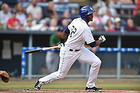 Asheville Tourists first baseman Correlle Prime #32 swings at a pitch during a game against the Savannah Sand Gnats at McCormick Field July 16, 2014 in Asheville, North Carolina. The Tourists defeated the Sand Gnats 6-3. (Tony Farlow/Four Seam Images)