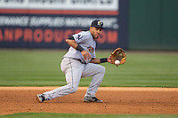 Scranton\Wilkes-Barre RailRiders third baseman Jonathan Galvez (44) fields a ground ball against the Charlotte Knights at BB&T BallPark on May 1, 2015 in Charlotte, North Carolina.  The RailRiders defeated the Knights 5-4.  (Brian Westerholt/Four Seam Images)