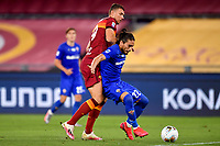 Edin Dzeko of AS Roma and Martin Caceres of ACF Fiorentina compete for the ball during the Serie A football match between AS Roma and ACF Fiorentina at stadio Olimpico in Roma (Italy), July 26th, 2020. Play resumes behind closed doors following the outbreak of the coronavirus disease. <br /> Photo Antonietta Baldassarre / Insidefoto