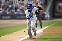 Vladimir Guerrero Jr. (47) of the Buffalo Bison takes off for home plate following a wild pitch during the game against the Charlotte Knights at BB&T BallPark on August 14, 2018 in Charlotte, North Carolina. The Bison defeated the Knights 14-5.  (Brian Westerholt/Four Seam Images)