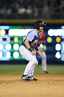 Charlie Tilson (4) of the Charlotte Knights takes his lead off of second base against the Indianapolis Indians at BB&T BallPark on April 27, 2019 in Charlotte, North Carolina. The Indians defeated the Knights 8-4. (Brian Westerholt/Four Seam Images)