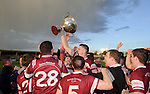 St Joseph's Doora Barefield players celebrate with the cup following their Intermediate county final win over Broadford  in Cusack Park. Photograph by John Kelly.