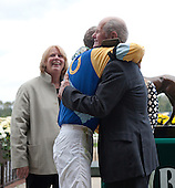 Bernie Dalton and Bruce Miller embrace as Sally Jeffords looks on after The Lonesome Glory.